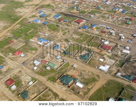 aerial view of tin shacks and dirt roads in Juba, capital of South Sudan