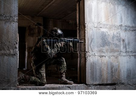 Soldier Aiming A Rifle In Ruins