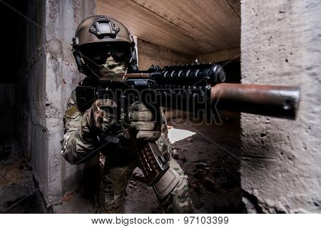 Portrait Of Armed Soldier During The Military Operation In A Buiding