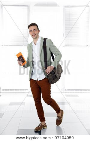 Man holding handbag on light background