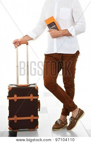 Man holding suitcase in airport
