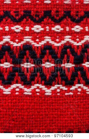 Close Up Of Red Woolen Texture And Design- Textile Background