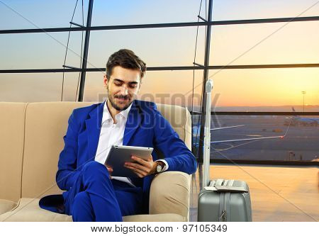Business man with suitcase in hall of airport