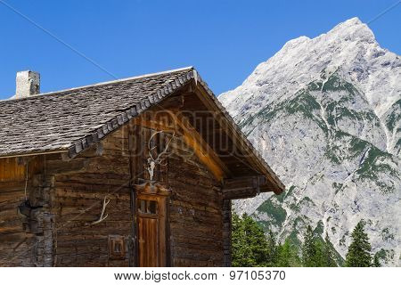 Rural Scene wit Mountain Range and old Alpine Hut