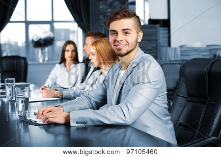 Businessman and business people working in conference room