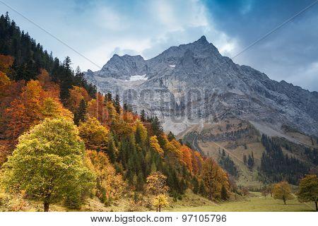 Alps autumn mountain landscape with dark blue sky. Austria Tirol.