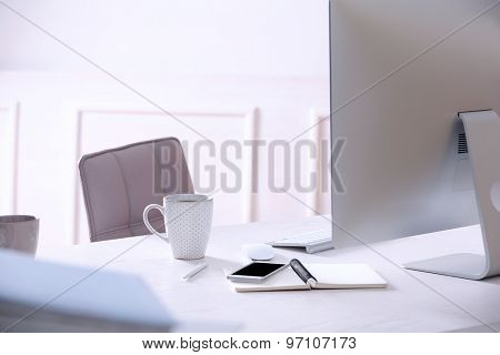 Workplace with computer in room