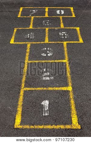 Hopscotch Popular Street Game In Schoolyard Pavement.