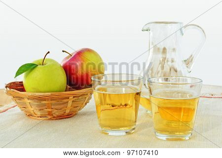 Hard Apple Cider In Glasses And Pitcher