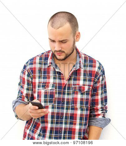 Guy With Beard Searching His Smart Phone For A Number