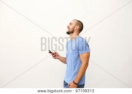 Cheerful Young Man Walking With Mobile Phone