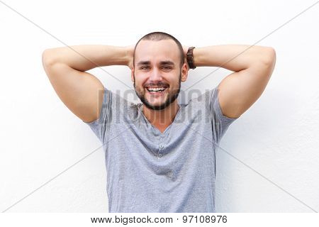 Handsome Young Man Smiling With Hands Behind Head