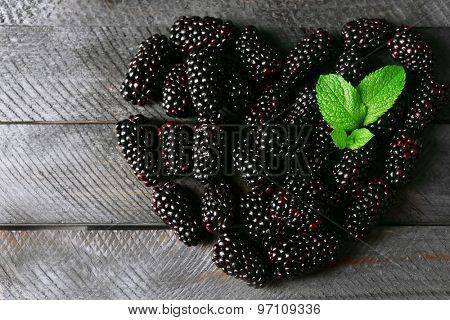Ripe blackberry on wooden background