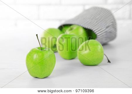 Green apples on table, closeup