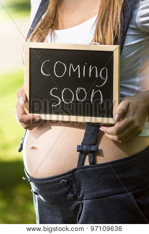 Pregnant Woman Holding Blackboard With Text