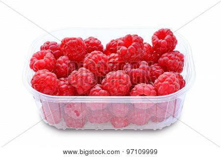 Raspberries In Plastic Box Isolated On White Background