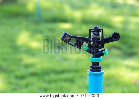 Black Sprinkler In The Garden