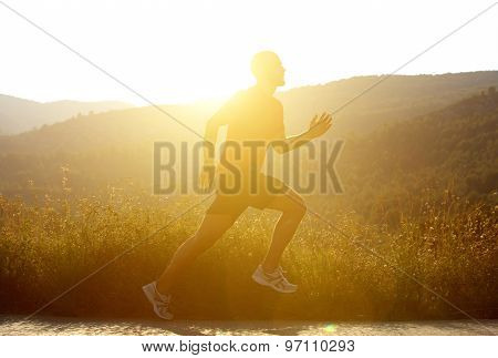 Man Running Outside With Sunset