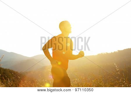 Silhouette Of A Man Running Outdoors