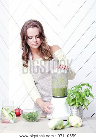 Cooking frame. Beautiful woman in the kitchen