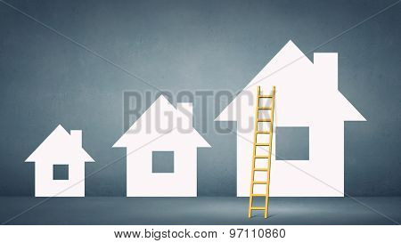 Conceptual image of ladder leading to house icon
