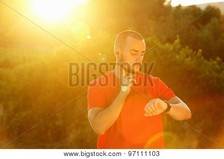 Sports Man Checking Pulse And Looking At Watch