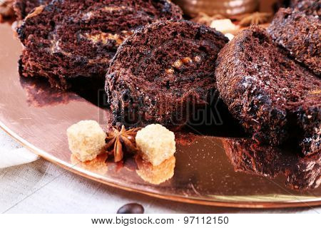 Delicious chocolate roll on metal plate, closeup