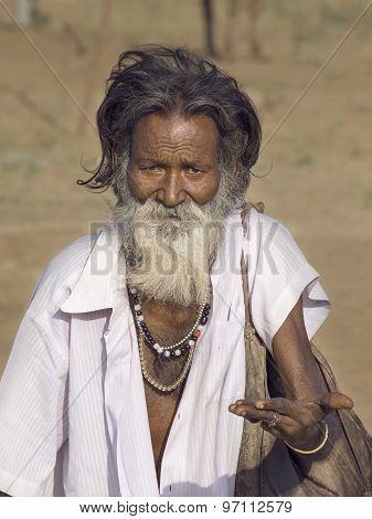 Old Indian Beggar Waits For Alms On A Street. Pushkar, India