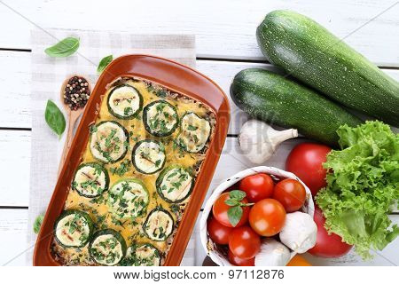 Casserole with vegetable mallow on wooden table, top view