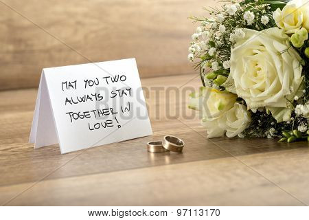 Wedding Greeting Card, Flowers And Rings On Table