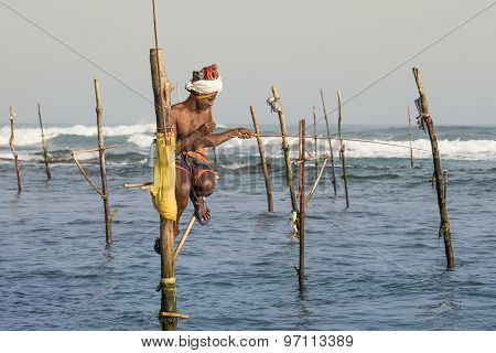 Fishermen Are Fishing In Unique Style. This Type Of Fishing Is Traditional For South Sri Lanka In In