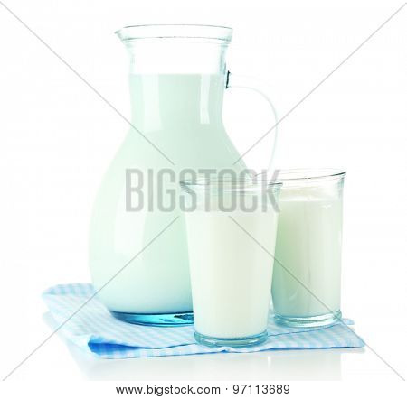 Pitcher and glasses of milk, isolated on white