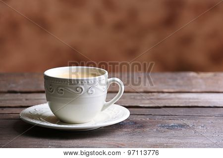 Cup of coffee on blurred background