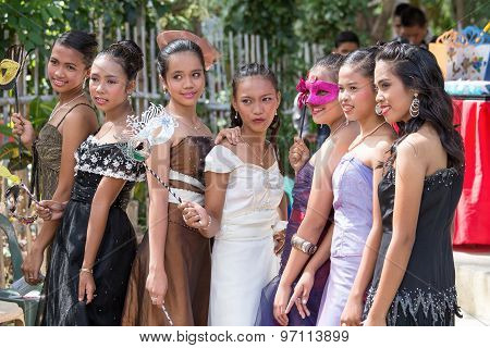 filipino students in the school yard have a masquerade ball