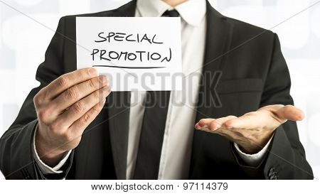 Close Up Businessman Or Salesman Holding Small Paper With Special Promotion  Message