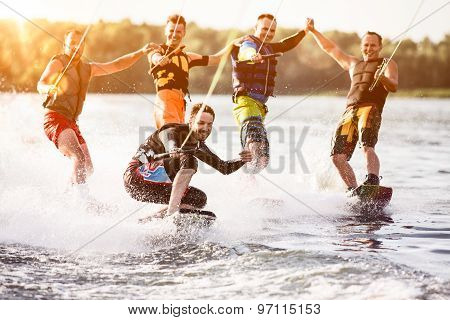 Five wakeboard riders having fun