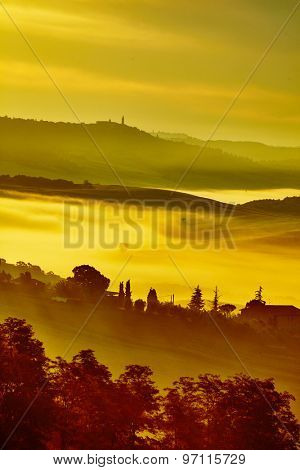 Scenic Tuscany landscape with rolling hills and valleys in golden morning light