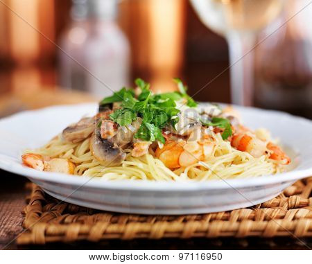 angel hair Italian shrimp pasta in champagne sauce with parsley and mushrooms