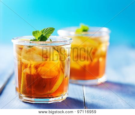 southern sweet tea in two cups on painted blue colorful table