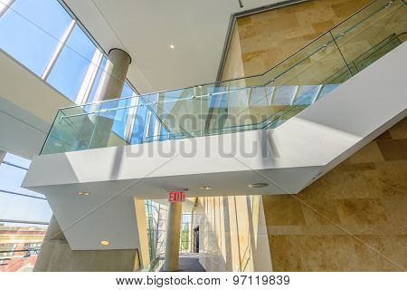 Windows and blue sky. Abstract fragment of the architecture of modern lobby, hallway of the luxury hotel, shopping mall, business center in Vancouver, Canada. Interior design.