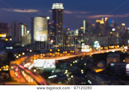 Blurred bokeh lights city building and traffic during twilight