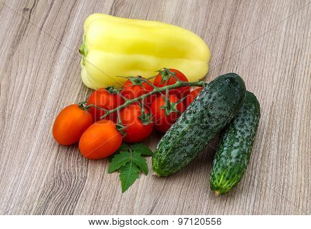 Cucumbers And Tomatoes On The Branch With Yellow Pepper
