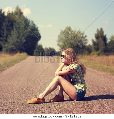 Street Style Fashion Woman Sitting on the Road Outdoors
