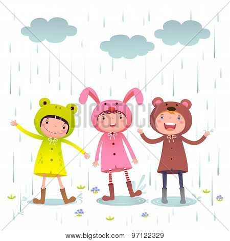 Kids Wearing Colorful Raincoats And Boots Playing On Rainy Day