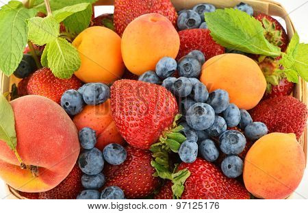 Strawberries, Apricots, Blueberries, Peach And Mint Isolated On White