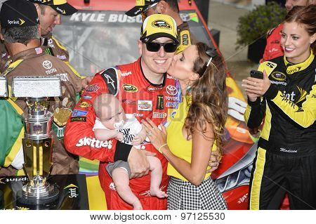 Indianapolis, IN - Jul 26, 2015: Kyle Busch (18) celebrates after winning the Crown Royal Presents the Jeff Kyle 400 at the Brickyard at Indianapolis Motor Speedway in Indianapolis, IN.