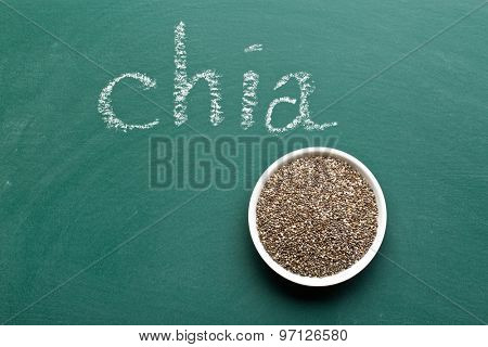 chia seeds in bowl on chalkboard