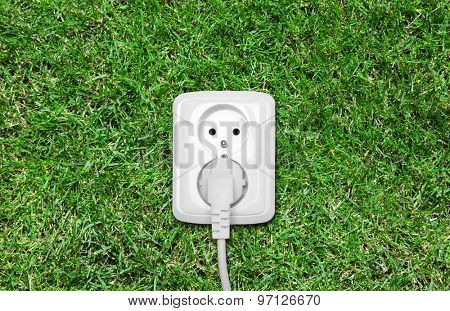 Electric outlet on green grass