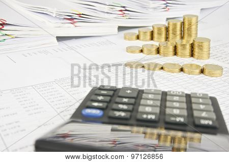 Reflection Step Pile Of Gold Coins In Calculator