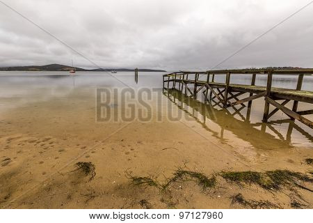 Wooden pier reflects